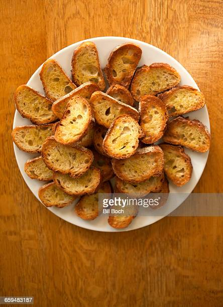 Fried crostini on a serving plate