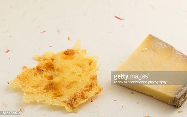 fried crusty cantal cheese and piece of cantal cheese. - crosta di formaggio foto e immagini stock
