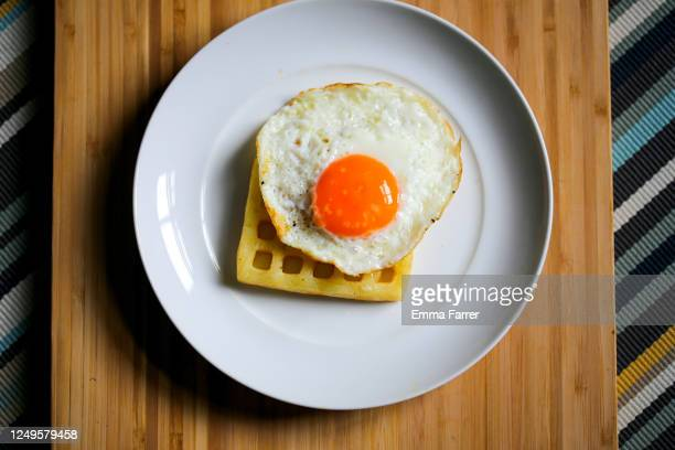 fried egg and waffle - prepared potato stock pictures, royalty-free photos & images