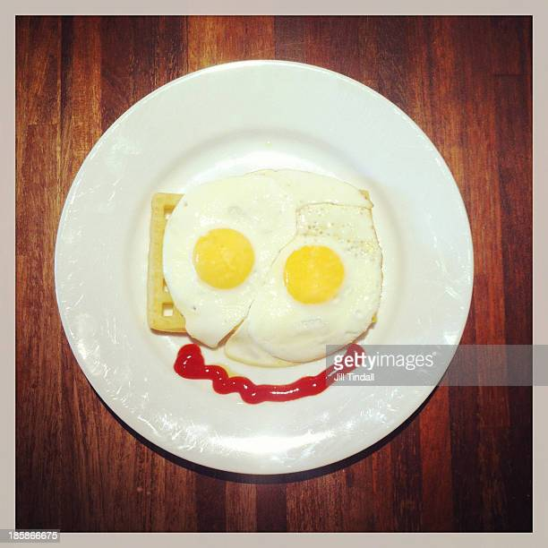 Fried egg breakfast funny face on plate