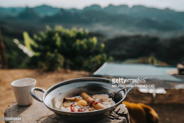 fried eggs and sausage in a pan, breakfast. - thai food stock pictures, royalty-free photos & images