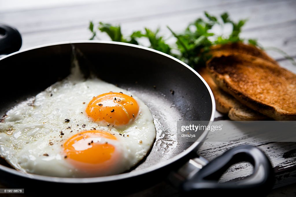 Fried eggs and toasted breads : Stock Photo