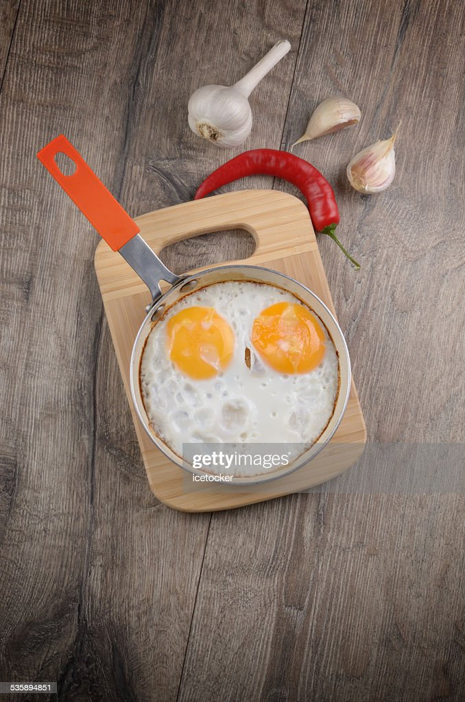 Fried eggs in pan : Stock Photo