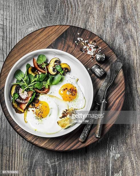 Fried eggs with salad