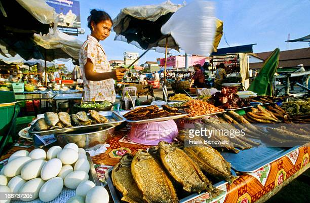 Fried fish and eggs sold on the street in Siem Reap