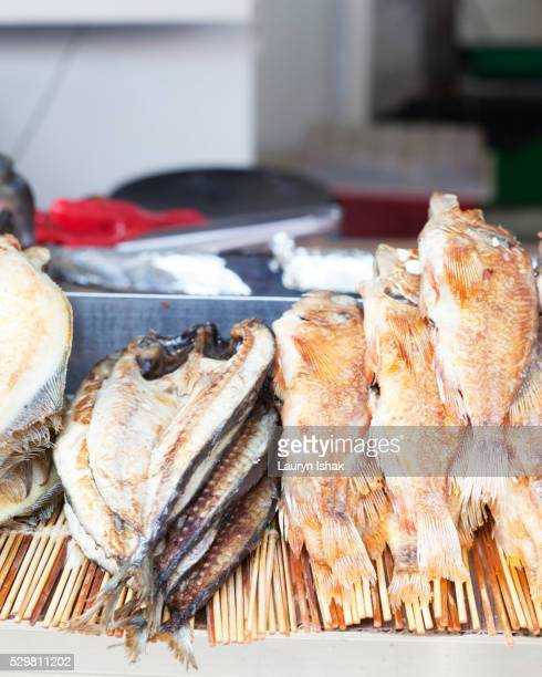 fried fish - lauryn ishak stock pictures, royalty-free photos & images