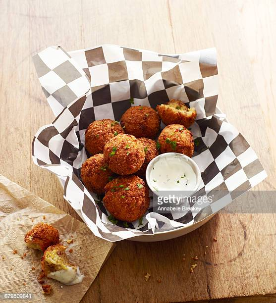 Fried funeral balls with ranch on checkered paper