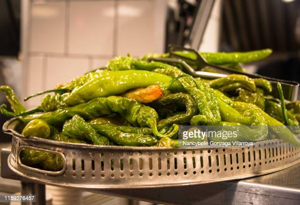 fried green hot peppers - nancybelle villarroya stock photos and pictures