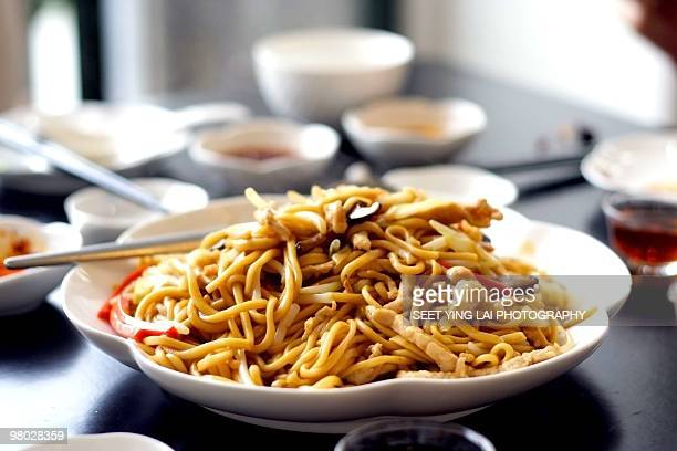 Fried noodles with soy sauce, vegetables and meats