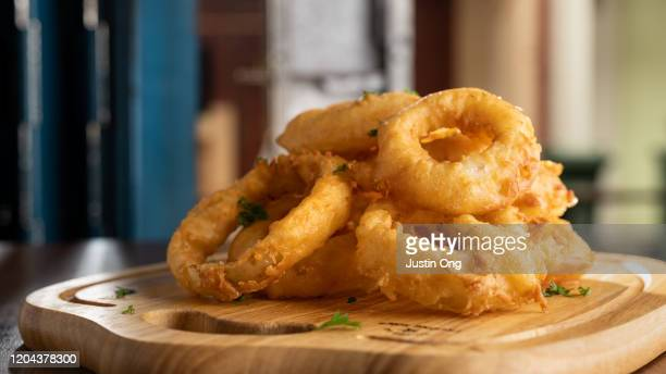 fried onion rings - fried stock pictures, royalty-free photos & images