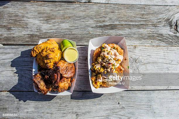 Fried organic chicken with curry dipping sauce, pumpkin biscuit, and kale slaw and Barbequed King Cole duck cakes with spicy corn relish