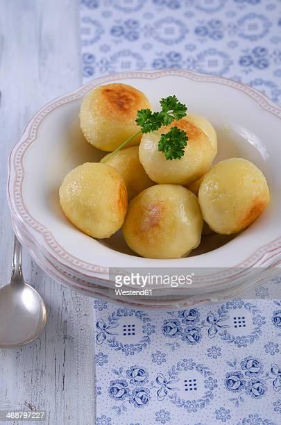 Fried potato dumplings in a bowl, studio shot