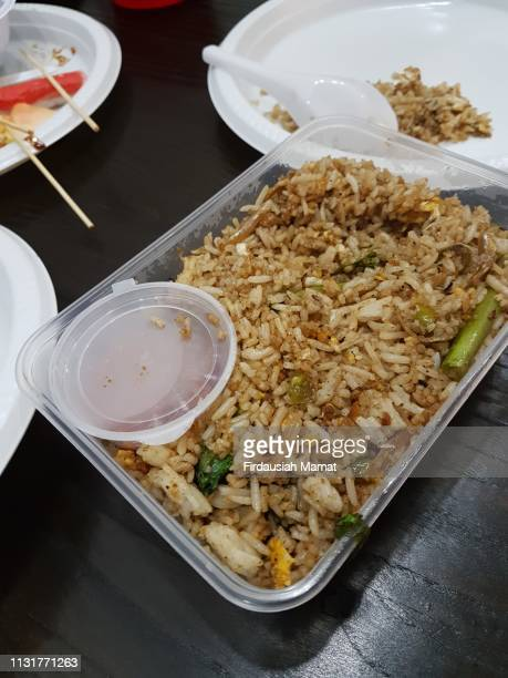 fried rice in plastic take away container - chinese takeout stock pictures, royalty-free photos & images