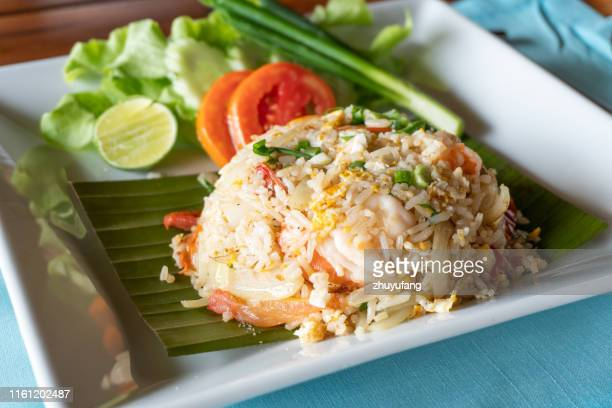 fried rice with shrimp in a white dish in thai food style - indochina stock pictures, royalty-free photos & images