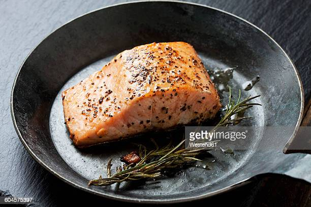 Fried salmon fillet in a frying pan