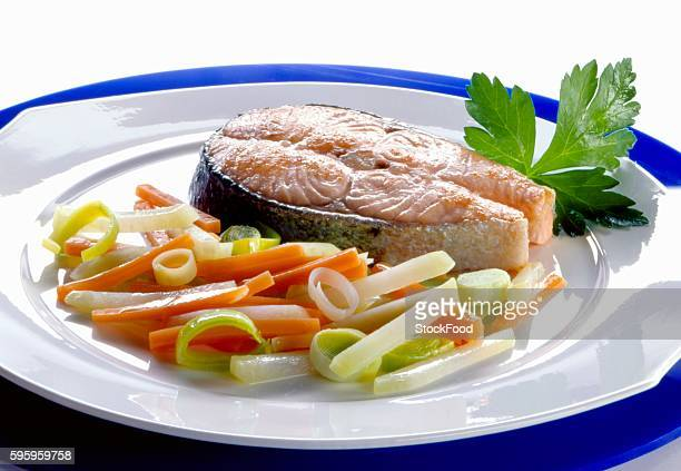Fried salmon steak and steamed vegetables
