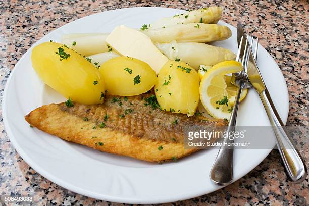 Fried salmon with asparagus, butter and boiled potatoes