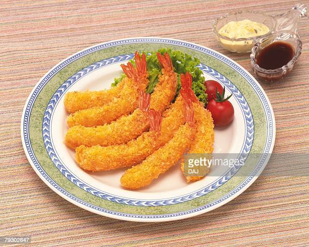 Fried shrimps on plate, high angle view