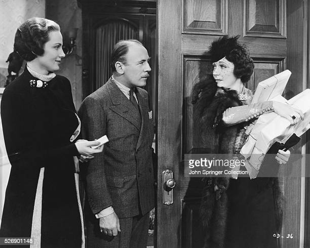 Frieda Inescort as Dorothy Hilton Roland Young as Frank Haines and Alice Brady as Muriel West in the 1937 film Call It a Day