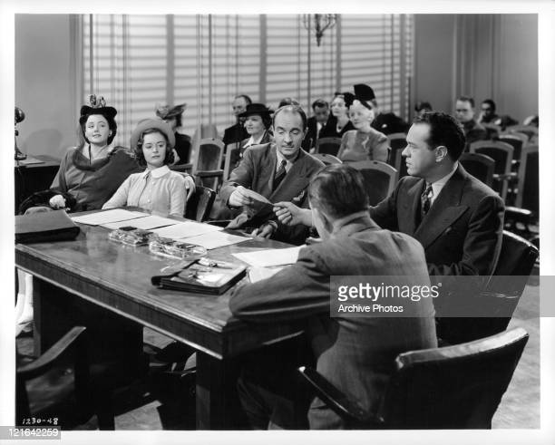Frieda Inescort Donna Reed and Harvey Stephens in court in a scene from the film 'The Courtship Of Andy Hardy' 1942
