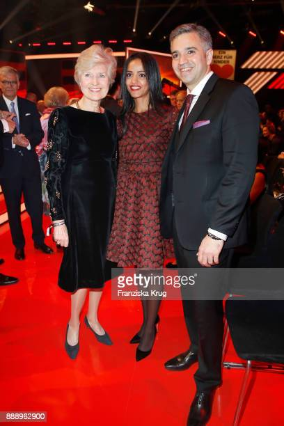 Friede Springer Sawsan Chebli and her husband Nizar Maarouf attend the Ein Herz Fuer Kinder Gala reception at Studio Berlin Adlershof on December 9...