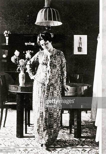 Friederike Maria Beer dressed with a housecoat of the Wiener Werkstätte sewed with the fabric Stichblatt by Ugo Zovetti Photo taken in a flat...