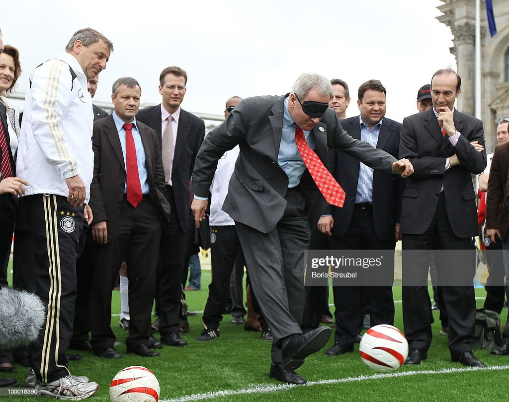 Friedhelm Julius Beucher, president of the German National Paralympic Committee ( Deutscher Behinderten Sportverband; DBS) handicaped with a mask, kicks a penalty on the 'Day of Blind Football�' in front of the Reichstag on May 20, 2010 in Berlin, Germany.