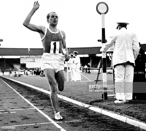 Friedrich Janke crosses the finish line to win the 10000 metre race at the White City Stadium in London circa July 1959