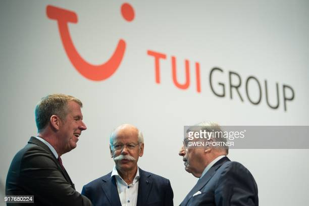 Friedrich Joussen CEO of German tourism giant TUI talks with Dieter Zetsche CEO of German auto giant Daimler AG and Klaus Mangold Chairman of the...