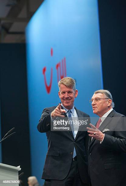 Friedrich Joussen chief executive officer of TUI AG left poses for a photograph beside Klaus Mangold chairman of TUI AG before the company announces...