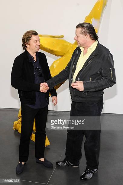 Friedrich Kunath and Georg Herold attend Georg Herold Dear Hunter on April 18 2013 in Los Angeles California
