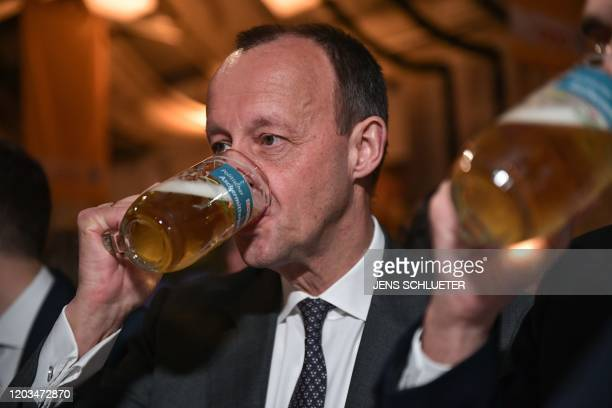 Friedrich Merz candidate for the Christian Democratic Union party leadership drinks a beer at the political Ash Wednesday meeting of the CDU in...