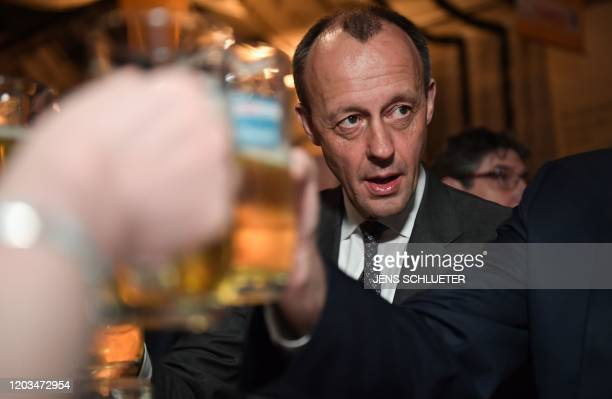 Friedrich Merz candidate for the Christian Democratic Union party leadership clinks his beer glass with party colleagues at the political Ash...