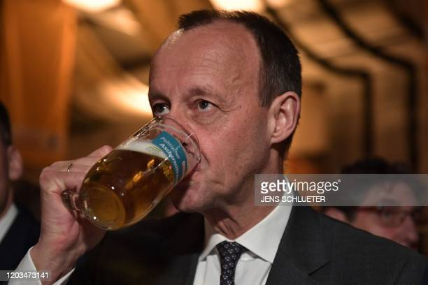 Friedrich Merz candidate for the Christian Democratic Union party leadership drinks his beer at the political Ash Wednesday meeting of the CDU in...