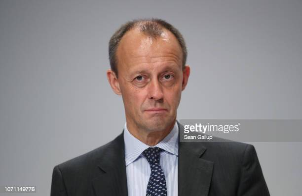 Friedrich Merz candidate to succeed Angela Merkel as leader of the German Christian Democrats listens to a question from the audience at a regional...