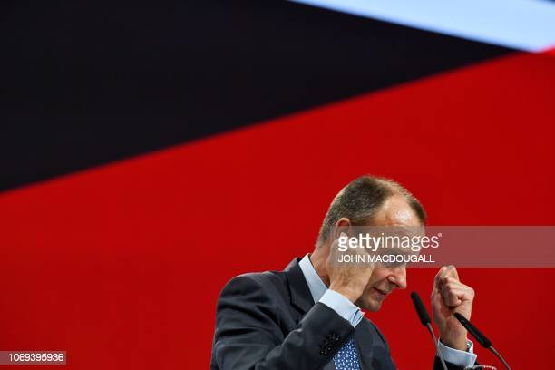 Friedrich Merz one of the top candidates for the CDU party's leadership and former CDU parliamentary group leader delivers a speech at a party...
