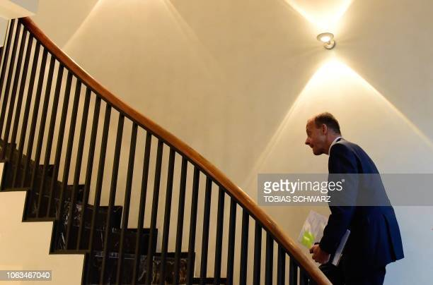 Friedrich Merz one of three top candidates to take over as head of Germany's centreright Christian Democratic Union walks up the stairs as he arrives...