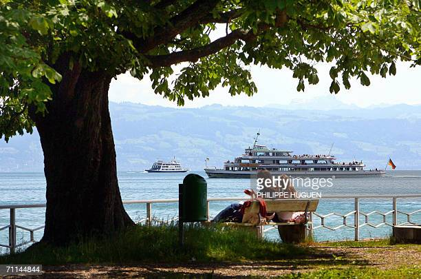 A pair of girls watch as a ferry crosses the waters of Lake Constance near Friedrichsafen 06 June 2006 Germany is hosting the FIFA World Cup 2006...