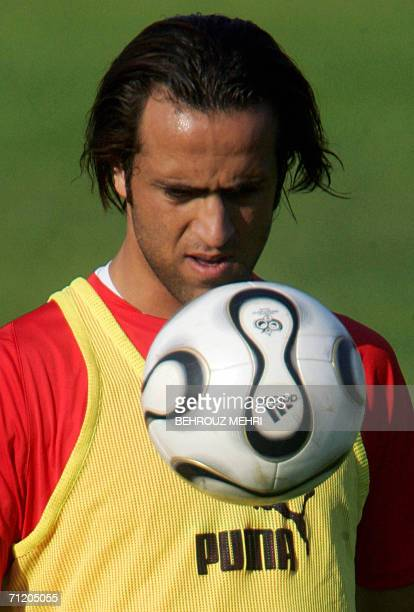 Iranian midfielder Ali Karimi plays with a ball during a training session in Friedrichshafen14 June 2006 Iran coach Branko Ivankovic will make...