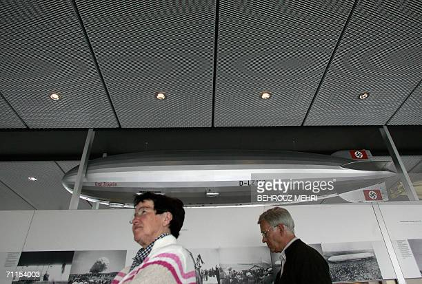 TO GO WITH AFP STORY FBLWC2006IRNZEPPELIN A couple visits the Zeppelin museum in Friedrichshafen 07 June 2006 As Iran's football team prepares for...
