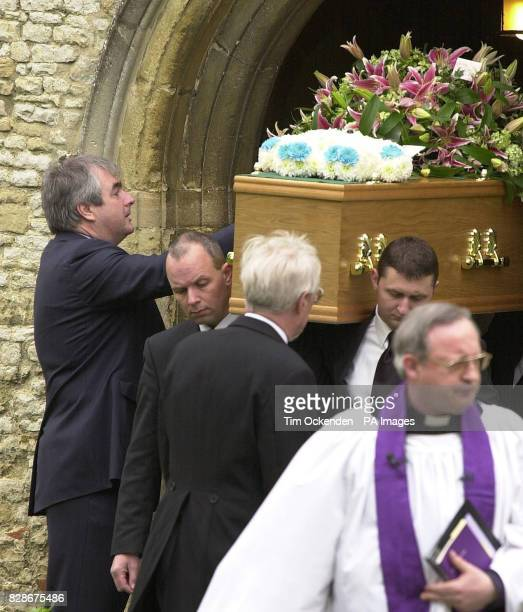 Friend and colleague Colin Baker says his goodbyes as the coffin of television reporter Terry Lloyd who died while covering the war in Iraq is...