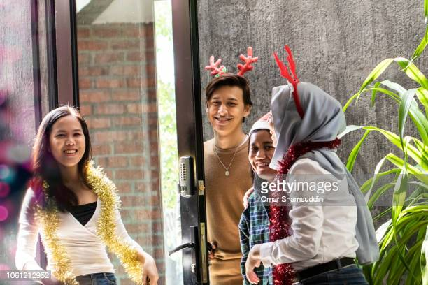 Friend arriving for Christmas party at home