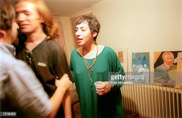 Friend congratulates Human Azizi, center, and his fiancee and poet, Mariam Houle, right, on their wedding June 11, 2001 at a party in northeastern...