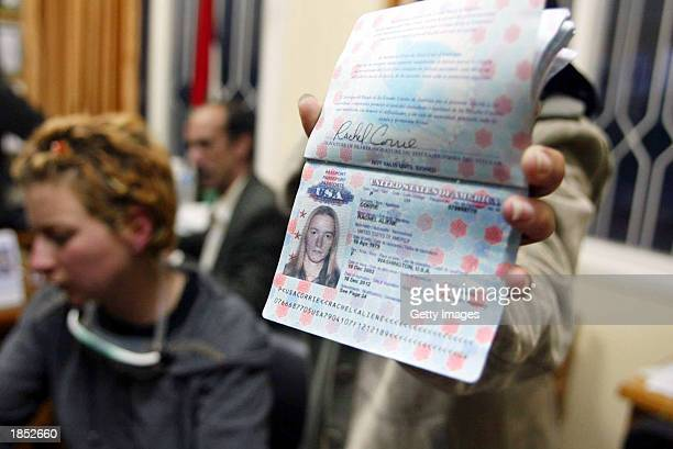 A friend holds her holds up 23yearold Rachel Corrie passport after hearing news Corrie's death at the Najar hospital March 16 2003 in the Rafah...