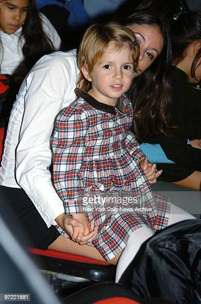 A friend holds Manzie Tio the daughter of Woody and SoonYi Allen at the Big Apple Circus' opening night gala benefit in Lincoln Center's Damrosch...