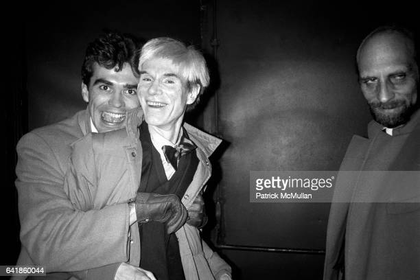 Friend hugging Andy Warhol and Michael Maslansky February 1981