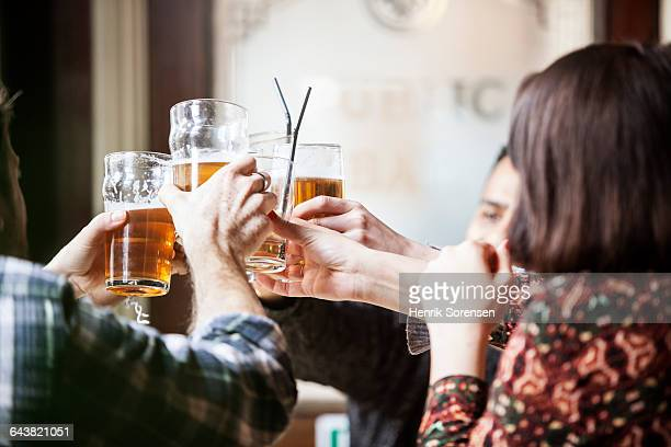 friend in a pub drinking beer - pub stock pictures, royalty-free photos & images
