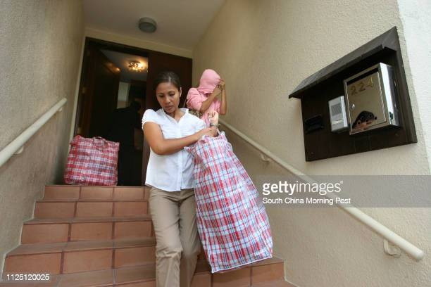 A friend of deceased Vicenta Flores arrives at the employers' house where Flores used to work to collect her belongings Filipino domestic helper...