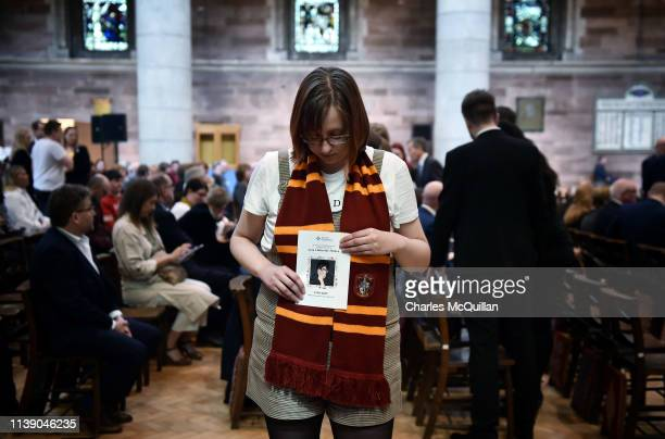 A friend of Lyra McKee holds an order of service as she attends the funeral of murdered journalist Lyra McKee as it takes place at St Anne's...