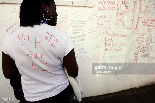 A friend of murdered teenager Kodjo Yenga looks at a wall covered in tributes near to where he was stabbed on Wednesday in Hammersmith Grove March 16...
